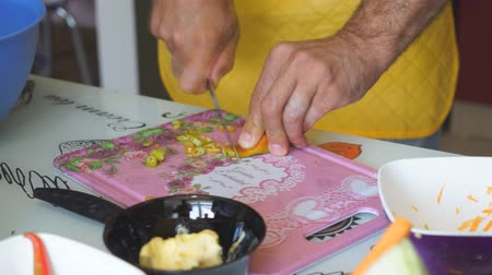 Chef cutting up an onion with a knife,