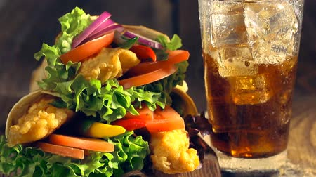 appetizers : Snach wrap with chicken and vegetables served with cold drink