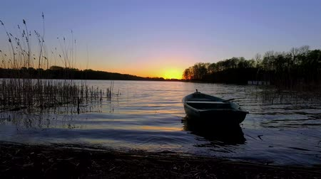 huzurlu : Tranquil dusk with the boat and lake