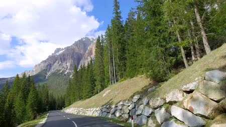 high speed road : Driving a car through the winding road, Dolomites, Italy