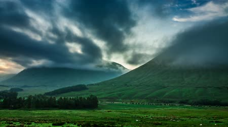coe : Beautiful foggy dawn over the mountains of Glencoe in Scotland, 4k, timelapse