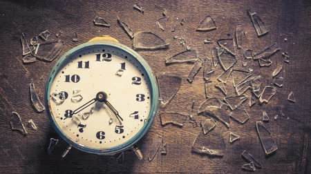 breaktime : Break time concept with looped clock and broken glass