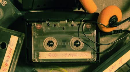песня : Spinning cassette tape  and a few old cassettes