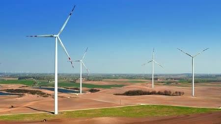 power plant : Farm of wind turbines on green field