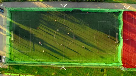 pole : Aerial view of a sports field with footballers playing, Poland Wideo