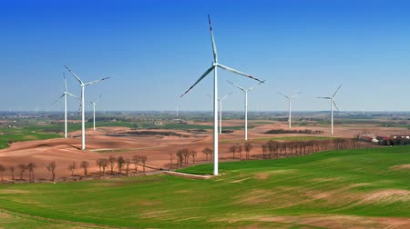 持続可能性 : Wind turbines on the field in spring, aerial view 動画素材