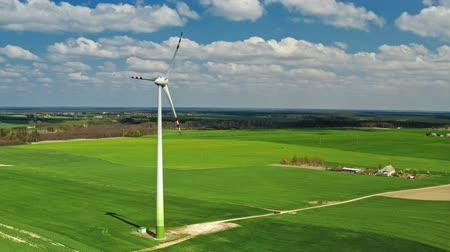 турбина : White wind turbines on green field in Poland, aerial view