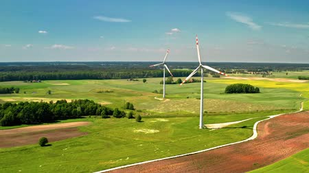 doğa : Two wind turbines on green field in summer Poland, aerial view