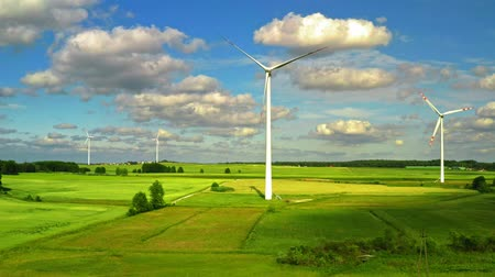 udržitelnost : Aerial view of wind turbines with blue sky on green field , Poland Dostupné videozáznamy
