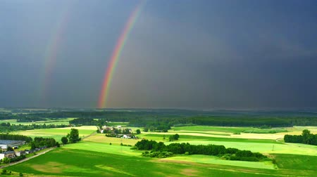 arco íris : Aerial view of rainbow over green fields after a storm