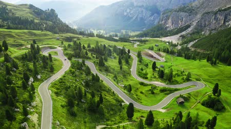 dolomit : Winding road at Passo Gardena, Dolomites, aerial view Stok Video