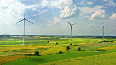 fenntartható : Wind turbines on green field in countryside, aerial view Stock mozgókép