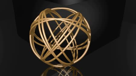 неровной : Golden spheric knot composed of golden rings. Object rotating uneven on black background. Mirroring of geometric body on glossy surface