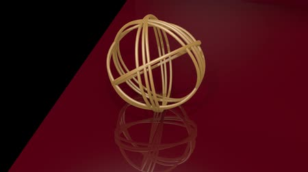 introduction video : Golden spheric knot composed of golden rings. Object rotating on black and dark red background. Mirroring of geometric body on glossy surface. Luxurious intro or outro movie