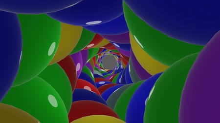 grafika : Tunnel animation with magnification, reduction and partial rotation, colorful glossy balls in vivid colors, 3d render