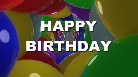 tünel : Happy birthday white lettering on tunnel background composed of shiny multicolored balls with reflections. Birthday party banner, anniversary greeting Stok Video