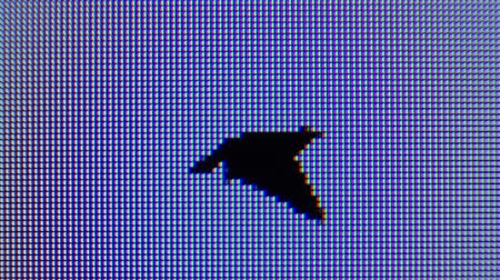 birds flying : Loopable animation of a polygonfaceted-style bird in flight, captured on computer screen with a macro lens.  Stock Footage