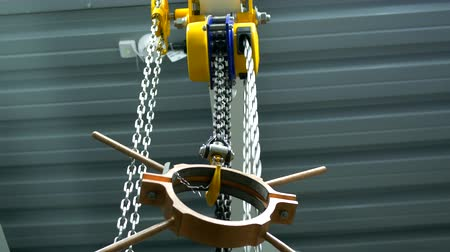 hawser : Chain winch lifts copper billet Stock Footage