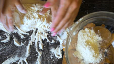baking ingredient : mother teaching her little daughter to cook and kneading a dough on the table in the kitchen.