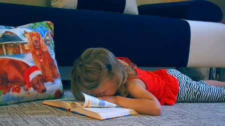 fed : little girl tired of reading a book