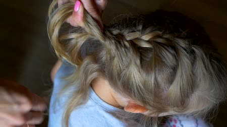 braid hair : Mom Plaits the Braid Of Her Little Daughter