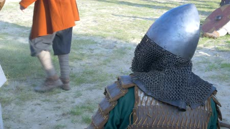 malienkolder : Warriors in medieval armor rest before the tournament starts.