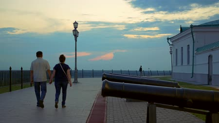 streetlights : Adult couple at sunset walking through the ancient streets holding hands Stock Footage