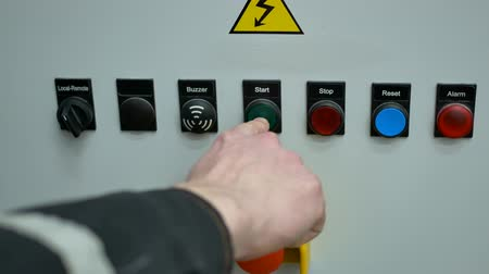 панель : A person clicks pushing start on the control panel buttons Стоковые видеозаписи