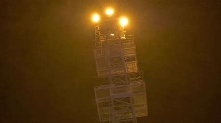 snow flurry : Light tower at night blizzard. Stock Footage