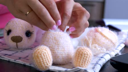 crochê : cotton toy stuffing. manual production of a teddy bear. repair knitted toys