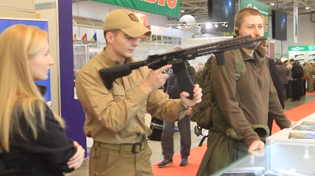 gunman : Kiev, Ukraine, October 2017: People view a weapon on the demonstration stand at arms exhibition