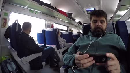 lizbona : People traveling inside train in high speed. Kiev, Ukraine, October 16, 2017. Scene inside train going in high speed with many people