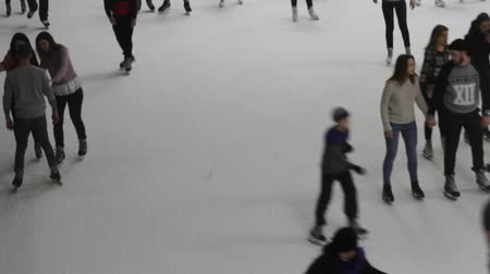 People ride ice skating on ice. People at the ice stadium are skating. Stock mozgókép