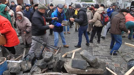 Ukraine. Kiev. December 5, 2017. People dismantle paving stones on the road and build barricades. Protest against the detention of Saakashvili.