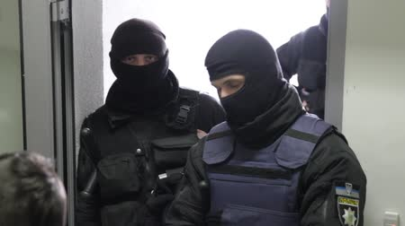 spec ops : Kyiv, 8 February, 2018, Ukraine. Special forces in masks blocking the entry into the office building. The police conduct a search in the office. Stock Footage