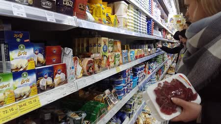 супермаркет : Kiev, March 6, 2018, Ukraine. Buyers in one of the supermarkets in Kiev buy cheese Стоковые видеозаписи