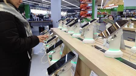 Kiev, March 6, 2018, Ukraine. The buyer chooses a smartphone on the counter in one of the electronics supermarkets in Kiev