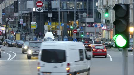 traffic lights in a street scene. Close up of urban city traffic light to red. Safety for drivers and pedestrians in crosswalk.