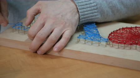 guerrilla : Accessories for needlework on wooden table. Stock Footage
