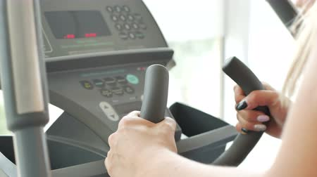 Treadmill and female hands Stock Footage
