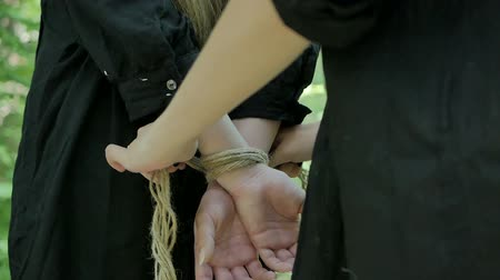 restraint : A crazy woman ties the girls hands with a rope and take her hostage