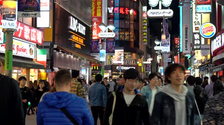attraversamento pedonale : Crowd of people in Shibuya shopping street district. Shibuya is known as one of the fashion centers of Japan for young people, and as a major nightlife area.
