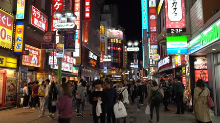 crossing road : Crowd of people in Shibuya shopping street district. Shibuya is known as one of the fashion centers of Japan for young people, and as a major nightlife area.