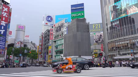 Mario Kart running on Shibuya Crossing (4K UHD). Tourist Rent a Go-kart can drive on Shibuya District, Harajuku and Omotesando all the famous shopping and sightseeing spot . Tokyo, Japan