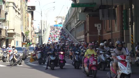 Scooter waterfall in Taiwan. Traffic jam crowded of motorcycles at rush hour on the ramp of Taipei Bridge, Cascade of scooters on Minquan West Road in Datong District, Taipei, Taiwan