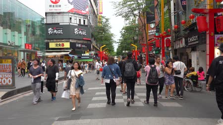 Taipei, Taiwan - June 19, 2019 : Walking on Ximending street market on daytime ( 4K UHD time-lapse ). A popular district in Taiwan, People visit for foods, shops, movie, fashion, cafes, restaurants.