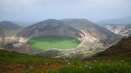 Beautiful view of Okama crater lake at Mount Zao in summer sunny day. active volcano in Miyagi Prefecture, Japan