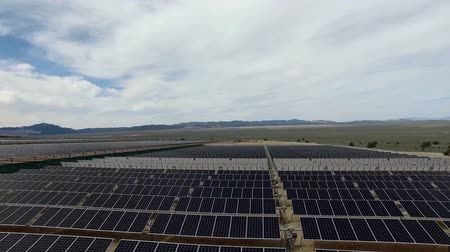 e : Aerial View. Flying over the solar power plant with sun. Solar panels and sun. Aerial drone shot.