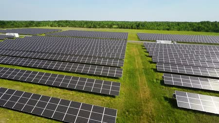 farm equipment : AERIAL, flight above solar panel electricity station for renewable green energy