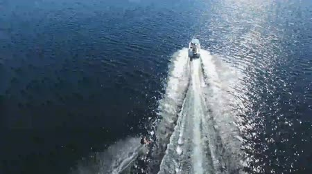 beautiful view : Beautiful aerial seascape shot of fast water skiing motor boat in big sea harbor